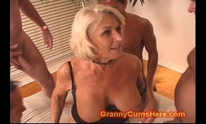 Granny acquires a gang bang with the addition of cum bath