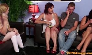 Two aunties examine him