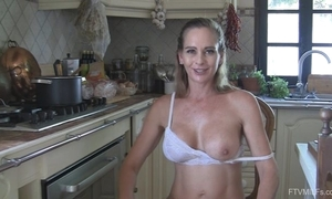 Juggy slutwife disrobes and masturbates encircling an obstacle kitchen